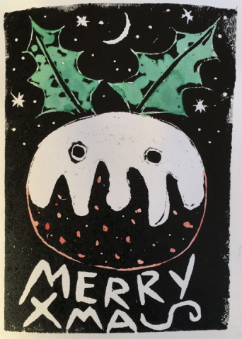 The image is a woodcut. It is on a black background with stars and a moon. The central image is a round Xmas pudding, with what could be custard dripping down. Below in bold handscript it says MERRY XMAS but the S of XMAS is lying down. The pudding has pink speckles below the custard. The custard has two round dots in it. They look like two eyes on a snowman, and there are two pieces of green holly sticking out at angles from the top of the pudding like ears. All in all it is a jolly Xmas pudding face.